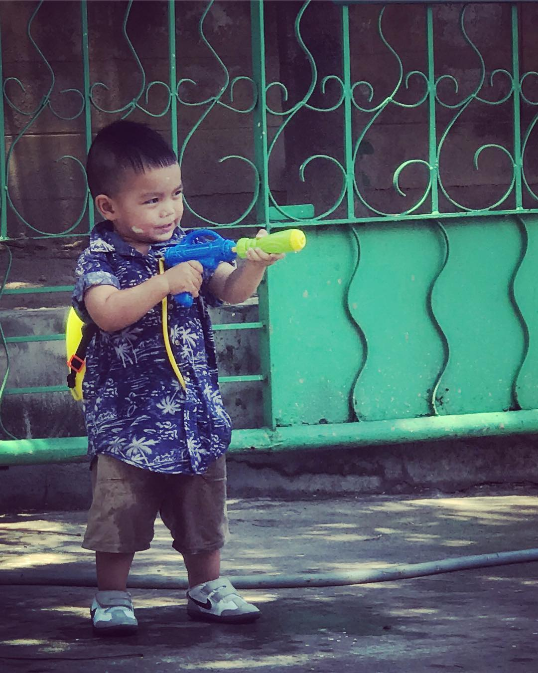 Tough guy with water gun during Songkran on 13 April in Thailand