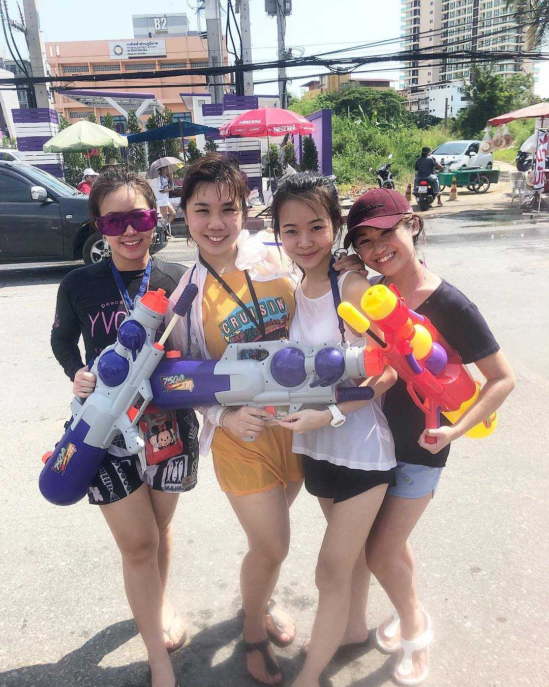 Four girls with big water guns times Songkran
