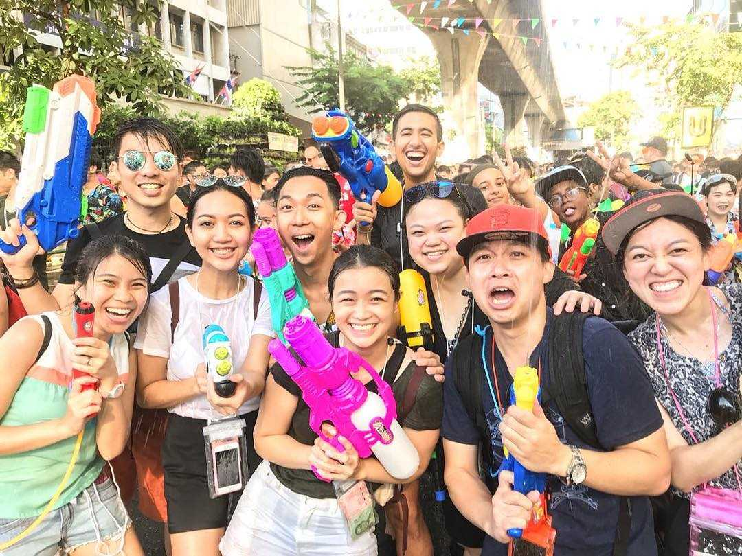 Group of happy people during Songkran