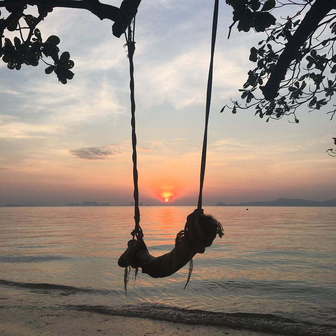 Sunset from Koh Kradan with a swing in the foreground