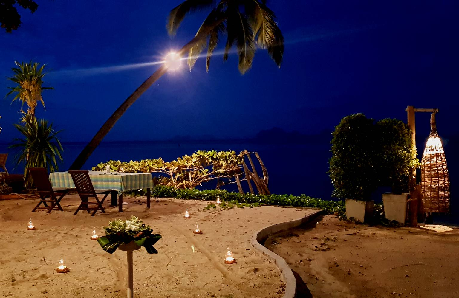 Romantic diner at the beach where Thapwarin Resort is located