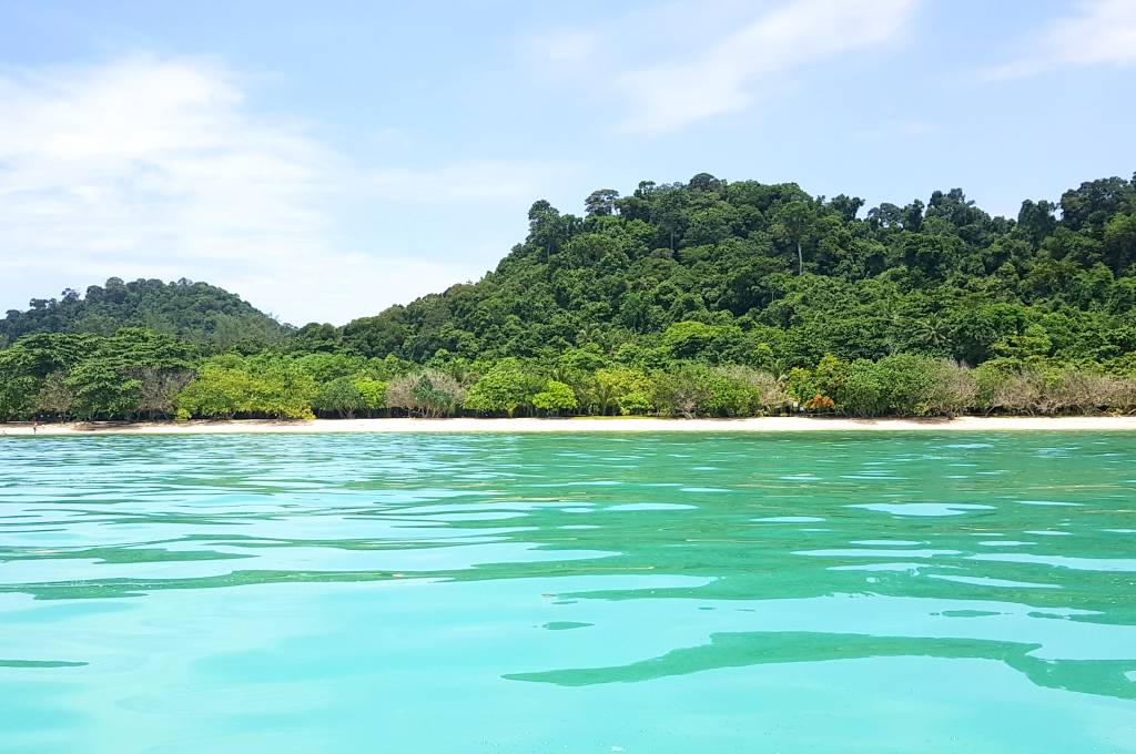 The island of Koh Kradan seen from a longtail boat at sea