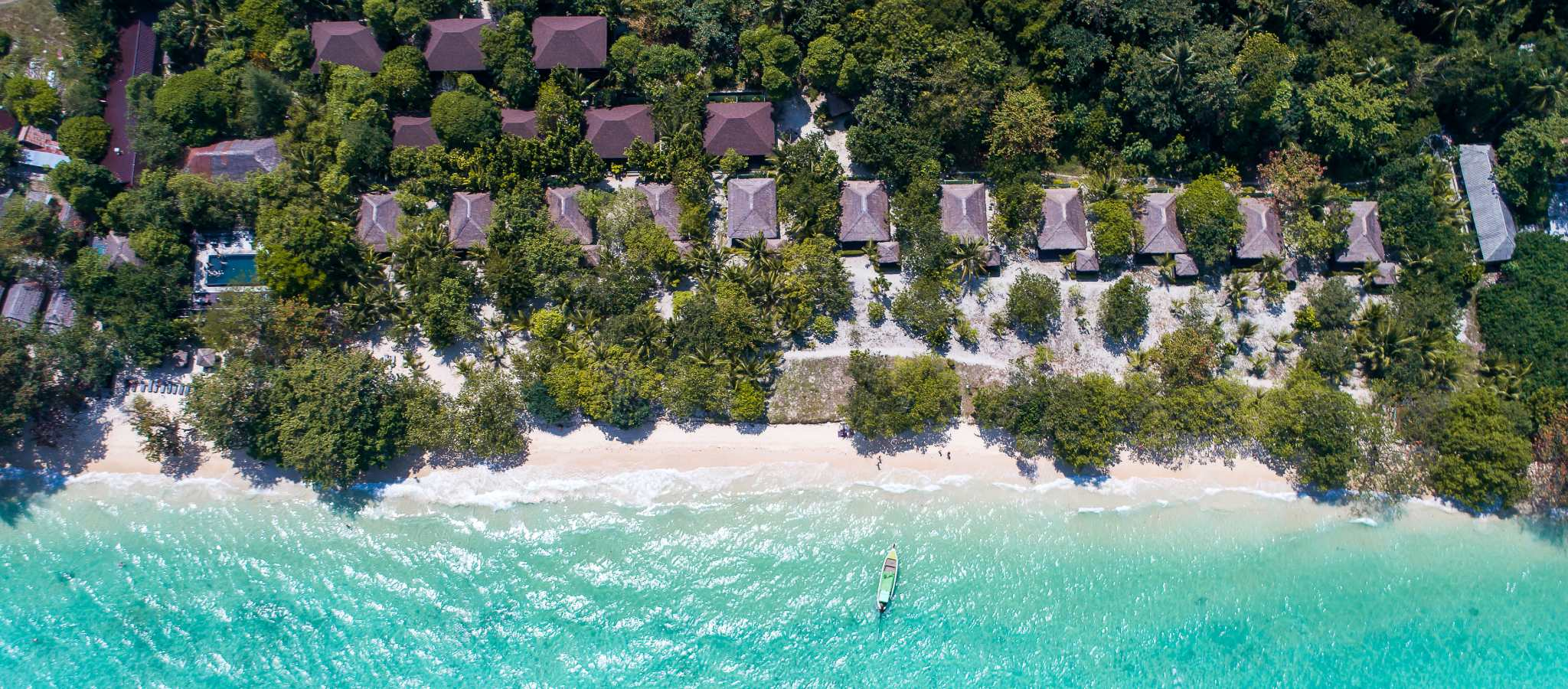 The grounds of The Sevenseas Resort on Koh Kradan seen from a drone