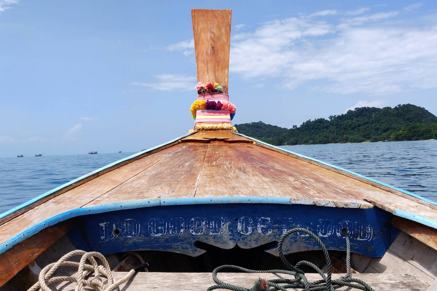 Do Good Get Good on a longtail boat on the way to Koh Kradan