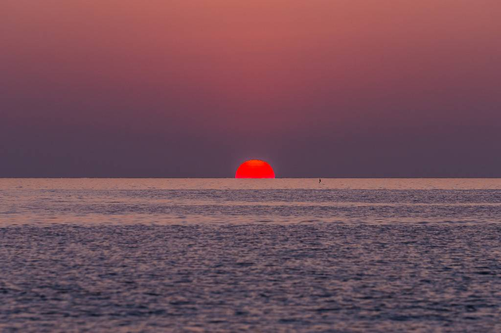 Watching the sun set from Sunset Beach on Koh Kradan
