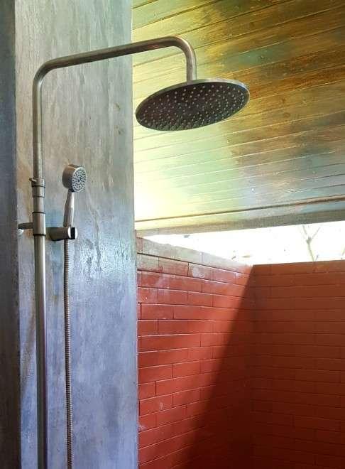 half open bathroom with rain shower