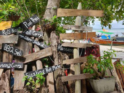 Wooden Signs With Names Of Thai Dishes On Them