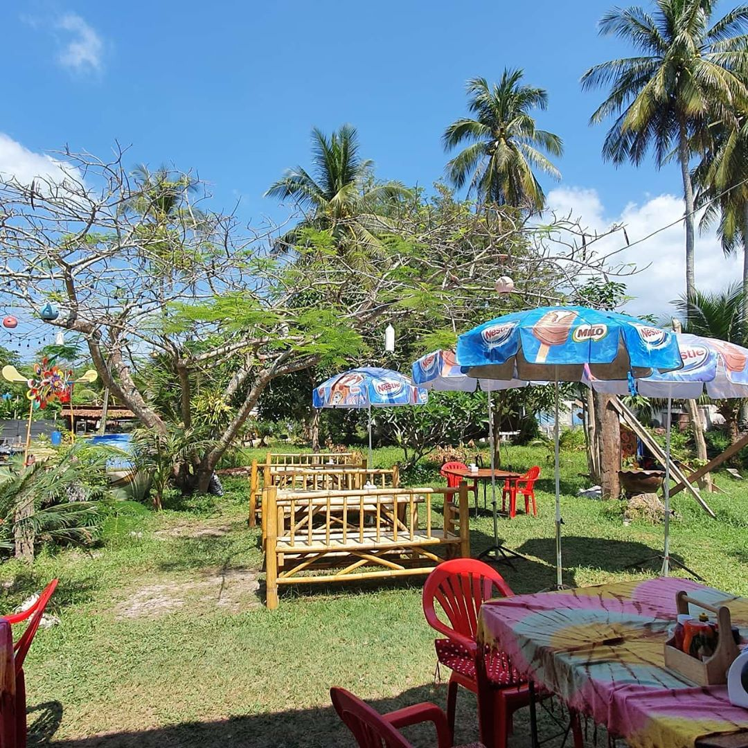 tables in the garden of Miss Bakery, Koh Mook