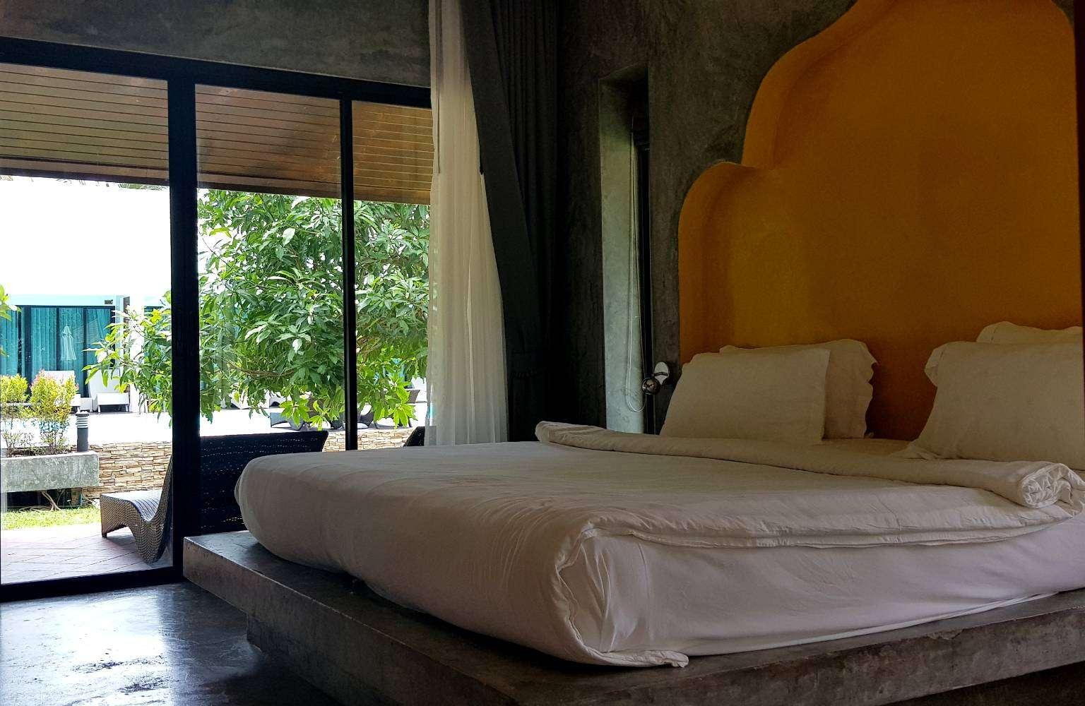 Bedroom overlooking the pool