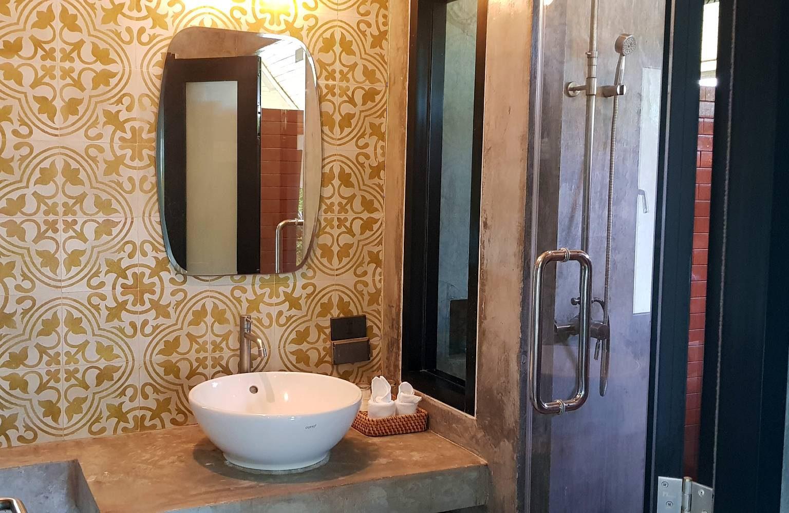 nice bathroom with washbasin outside shower