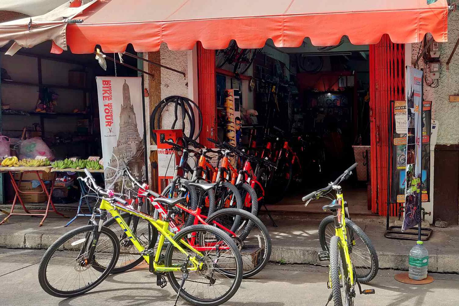 Bicycles in front of the door of bicycle rental company in Bangkok