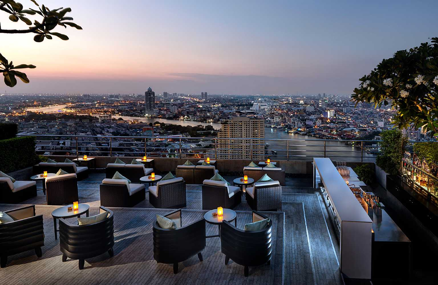 Millennium Hilton Bangkok - lounge area on sky bar overlooking the river