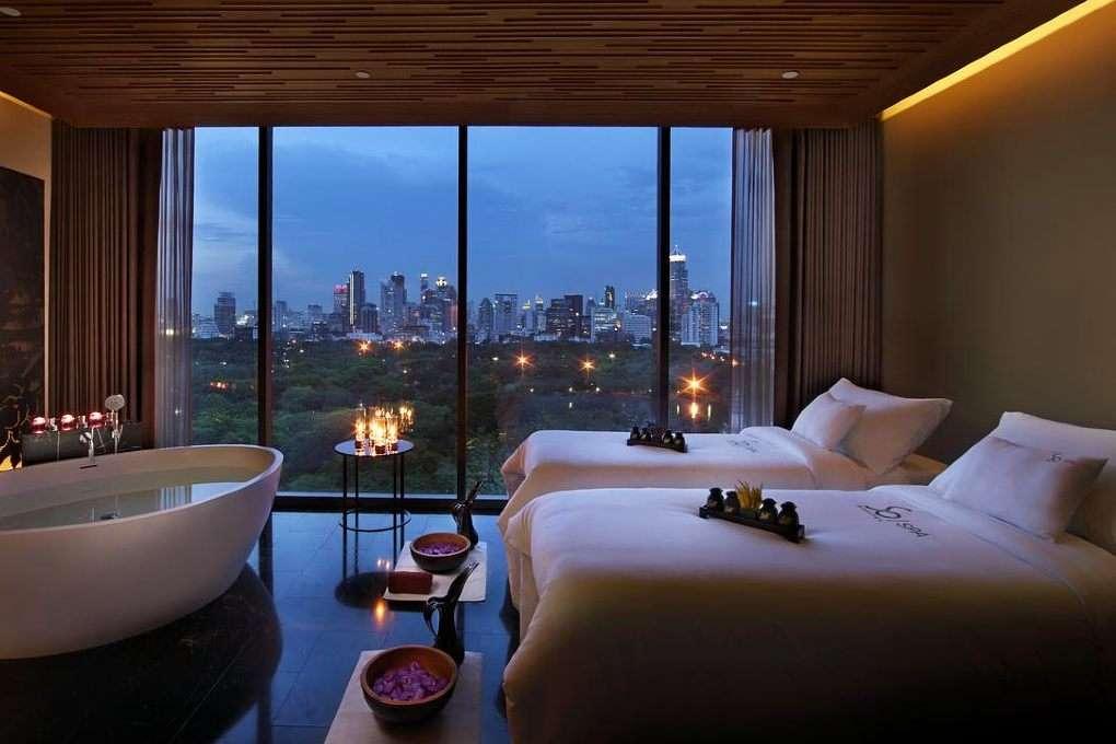 Hotel SO BANGKOK Silom - Luxury Hotel room with bath and large windows overlooking Bangkok