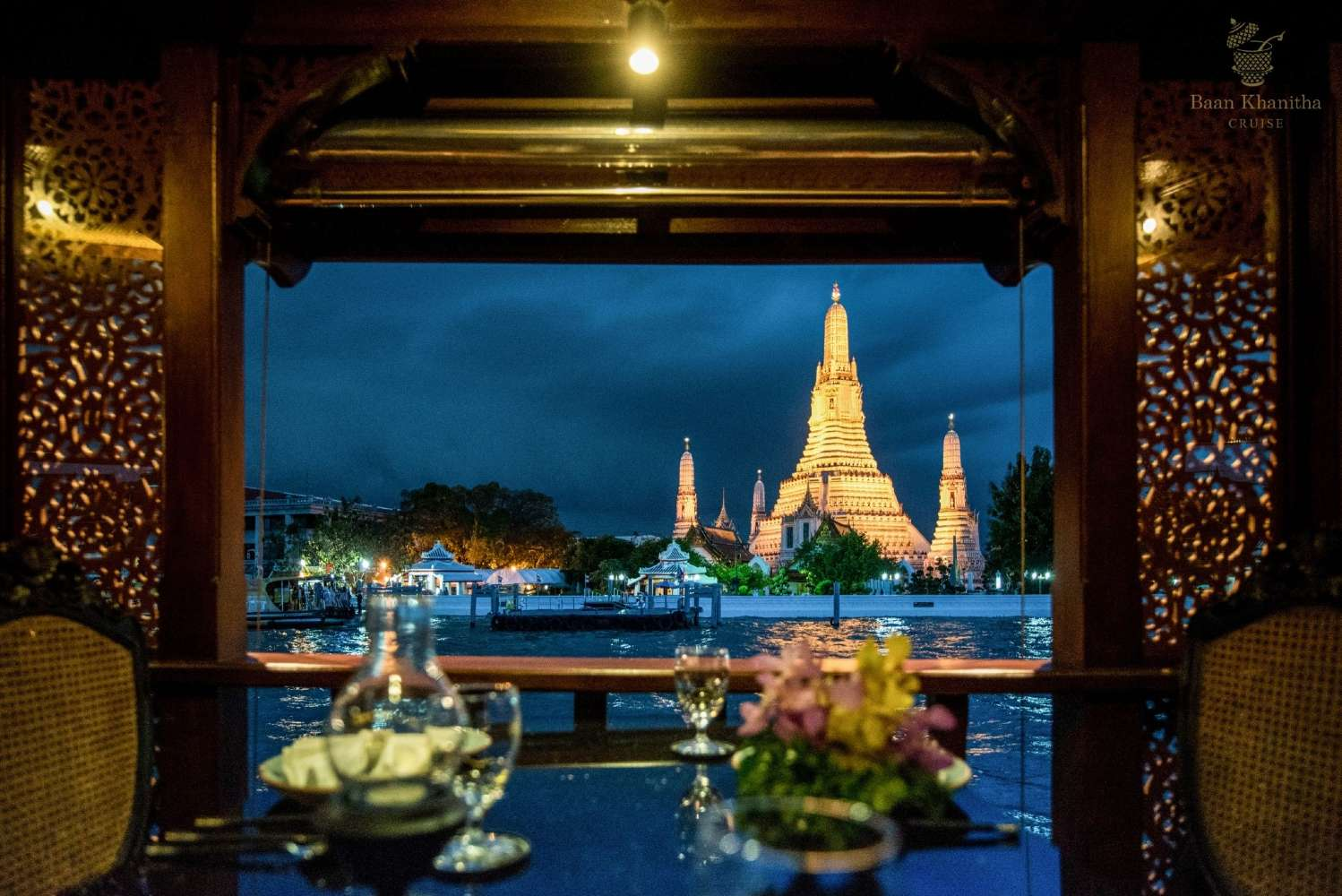 View of the Wat Arun during the Baan Khanitha Cruise over the Chao Phraya River in Bangkok.