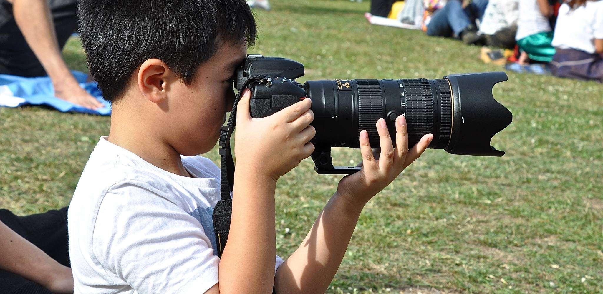 Thai boy with Dad's camera