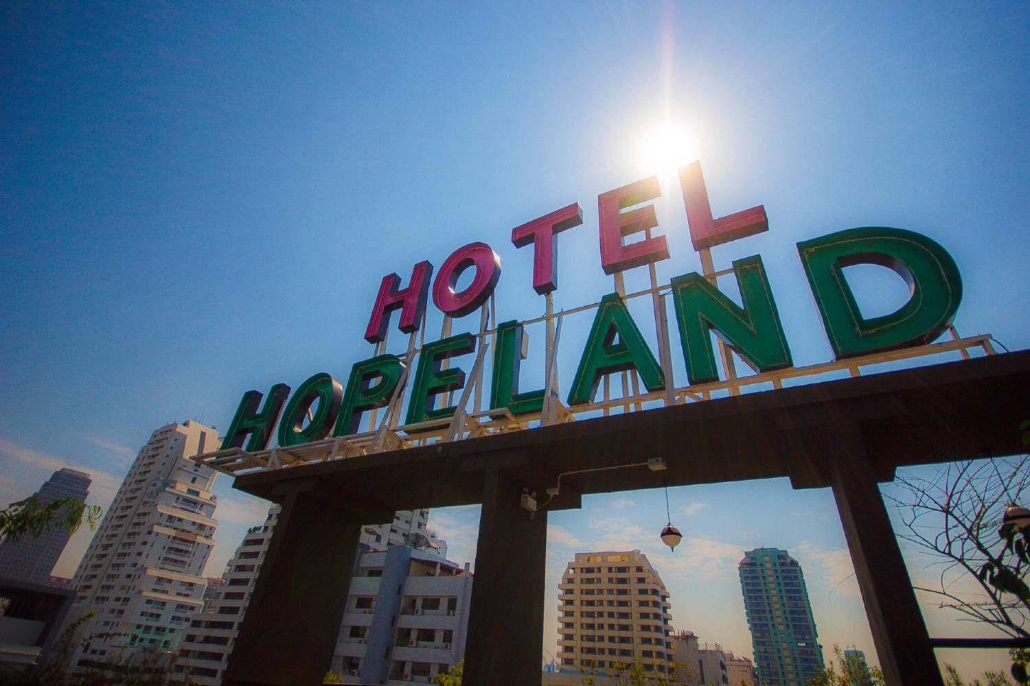 The neon sign on the roof of Hope Land Hotel Sukhumvit 8 in Bangkok, Thailand
