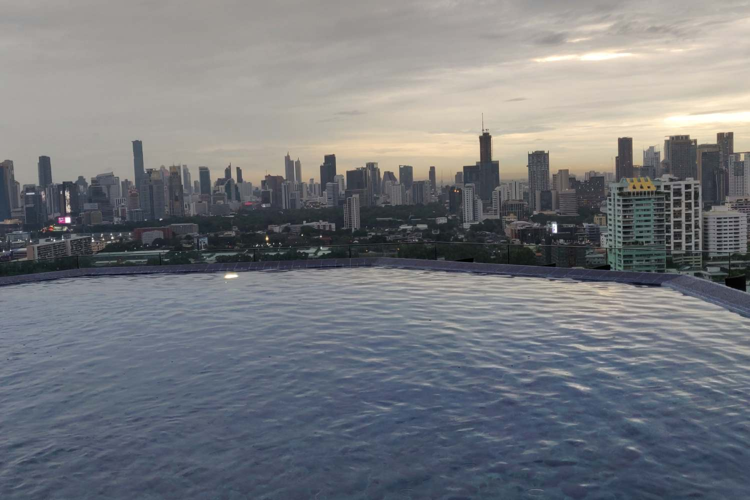 The pool at Long Table overlooking the sky line of Bangkok