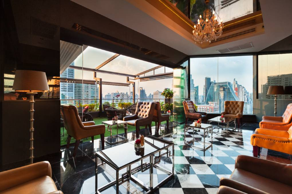 The indoor seating area of 1826 Mixologist & Rooftop Bar on the roof of Rembrandt Hotel & Suites in Bangkok, Thailand.