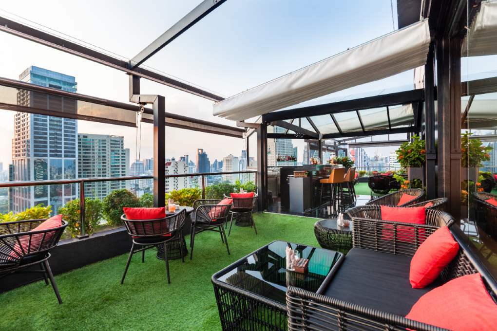 The outdoor seating area of 1826 Mixologist & Rooftop Bar on the roof of Rembrandt Hotel & Suites in Bangkok, Thailand.