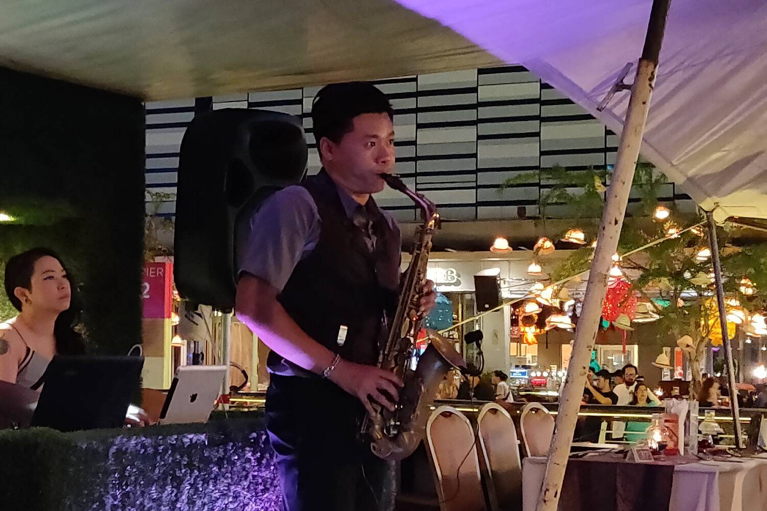 Performance saxophone player for guests