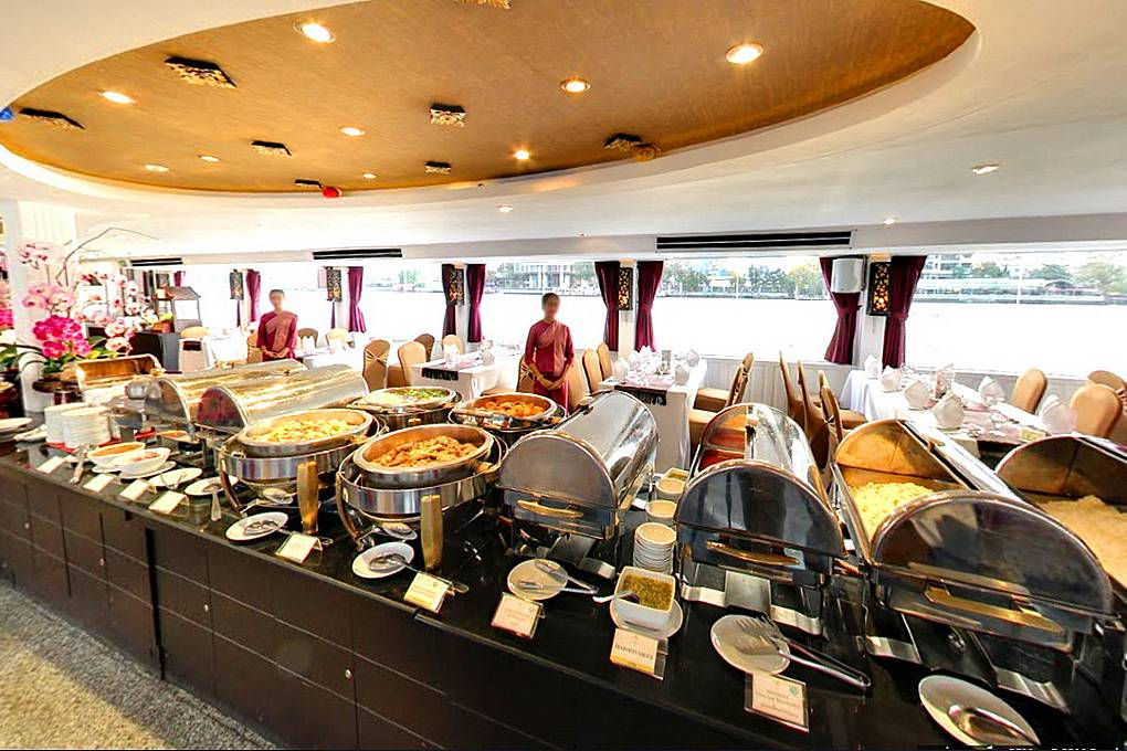 Dinner buffet with large dishes and bowls