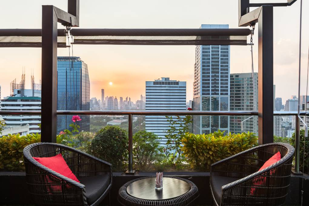 Seats overlooking the skyline of Bangkok from 1826 Mixology & Roof Top Bar