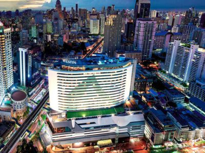 The Westin Grande Sukhumvit Seen From The Air In The Middle Of The Asok Area Of Bangkok During The Evening.
