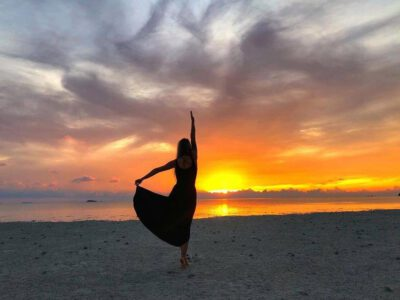 Girl Dancing On Koh Phangan Beach At Sunset