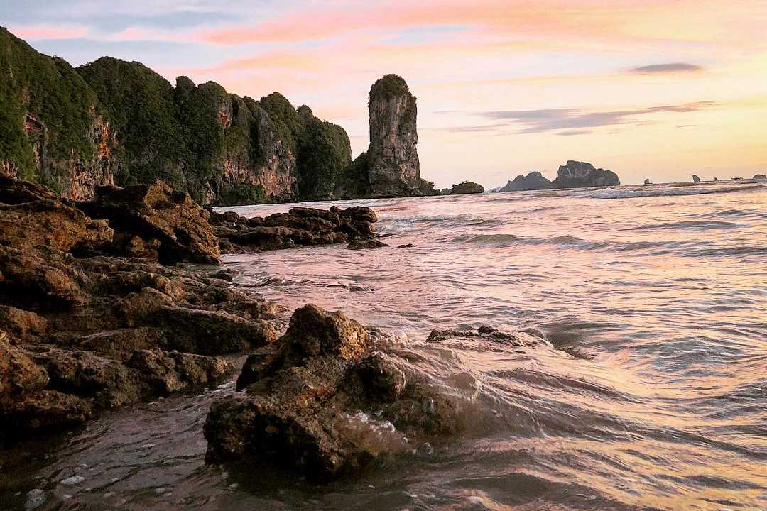 The limestone cliffs of Ao Nang with Railay behind them