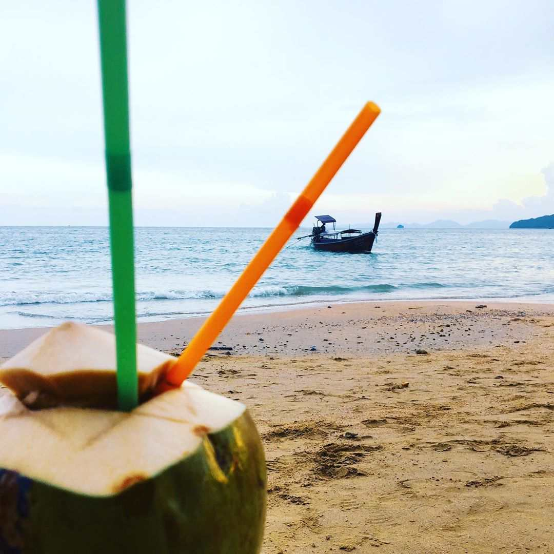Drinking a coconut on the beach of Ao Nang