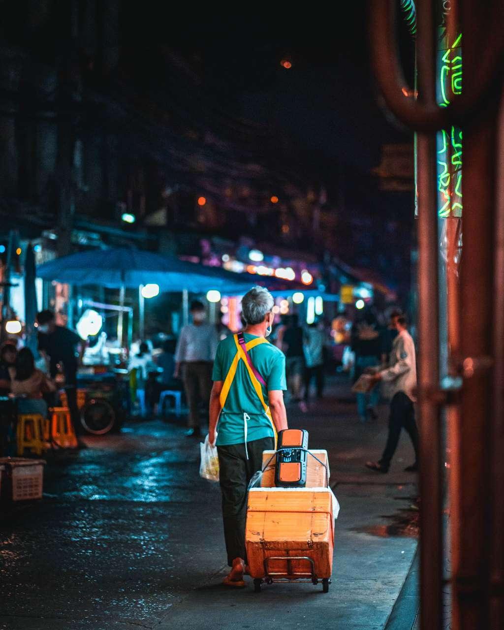 Bangkok street food vendor going home