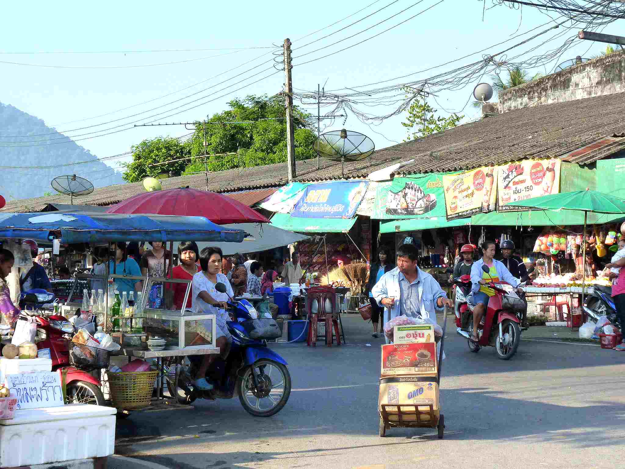 lively Khura Buri Food Market with stalls