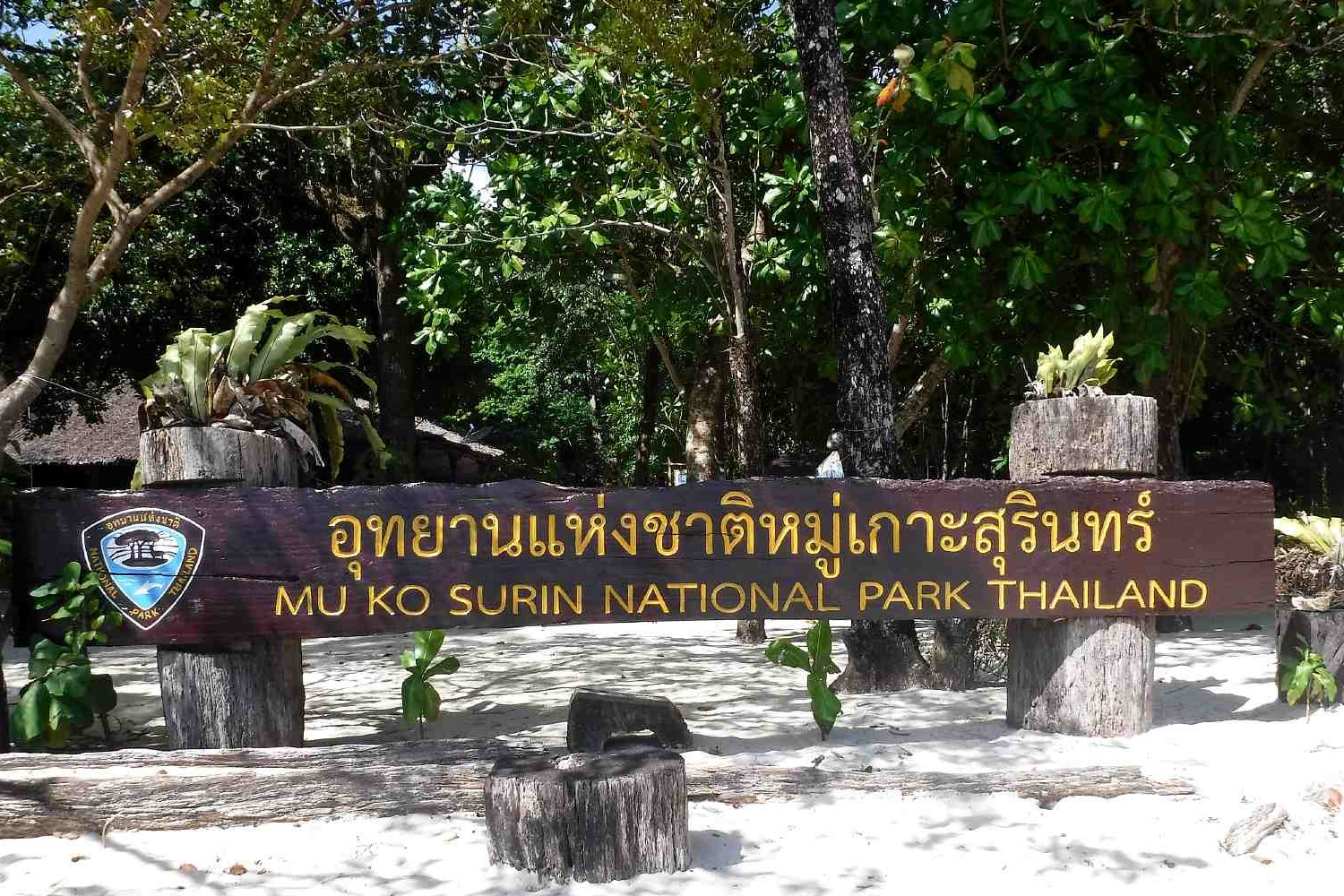 Wooden sign with text Mu Ko Surin National Park