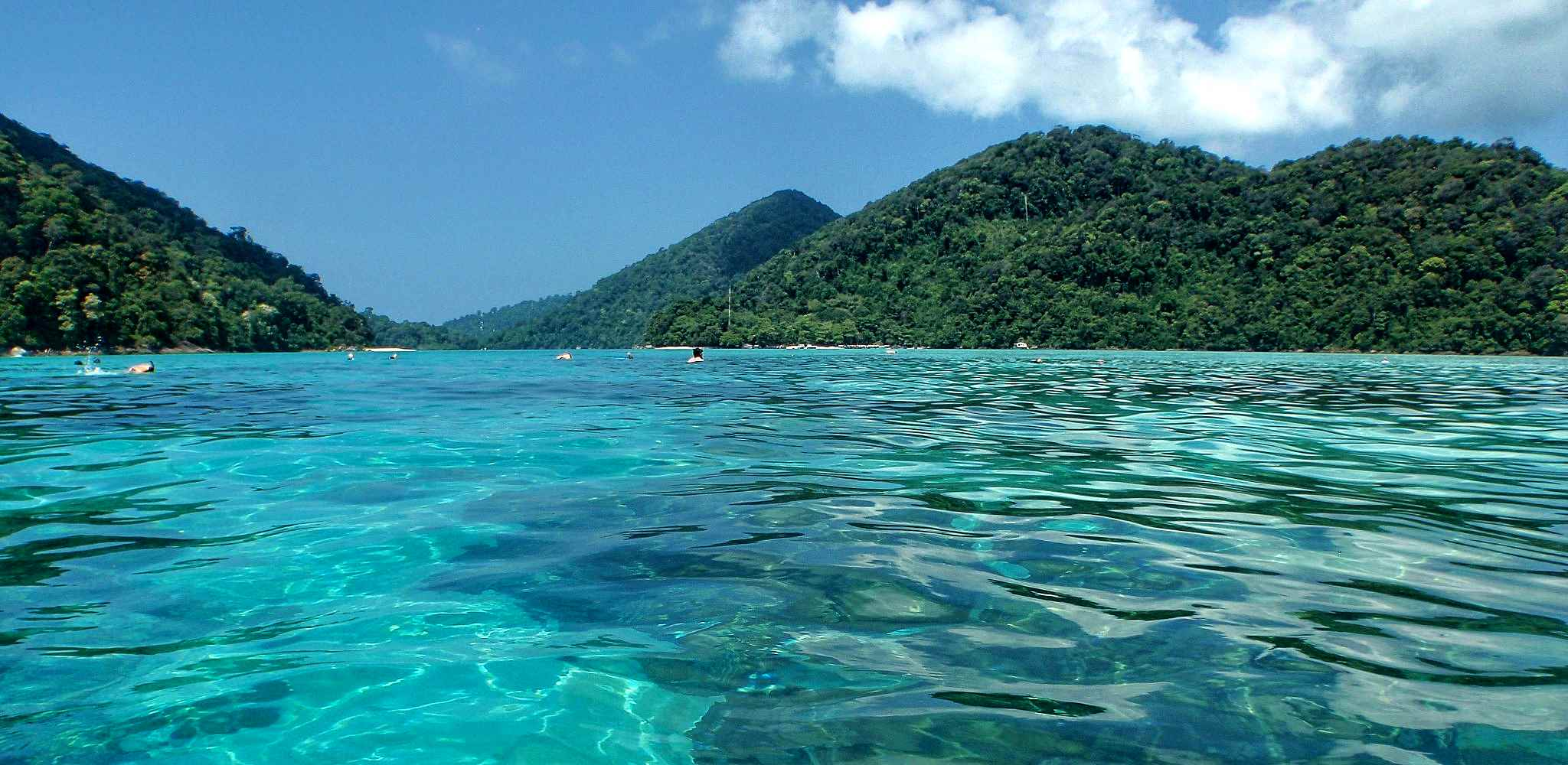 Mu Ko Surin National Park, crystal clear water surrounded by islands with lush green hills