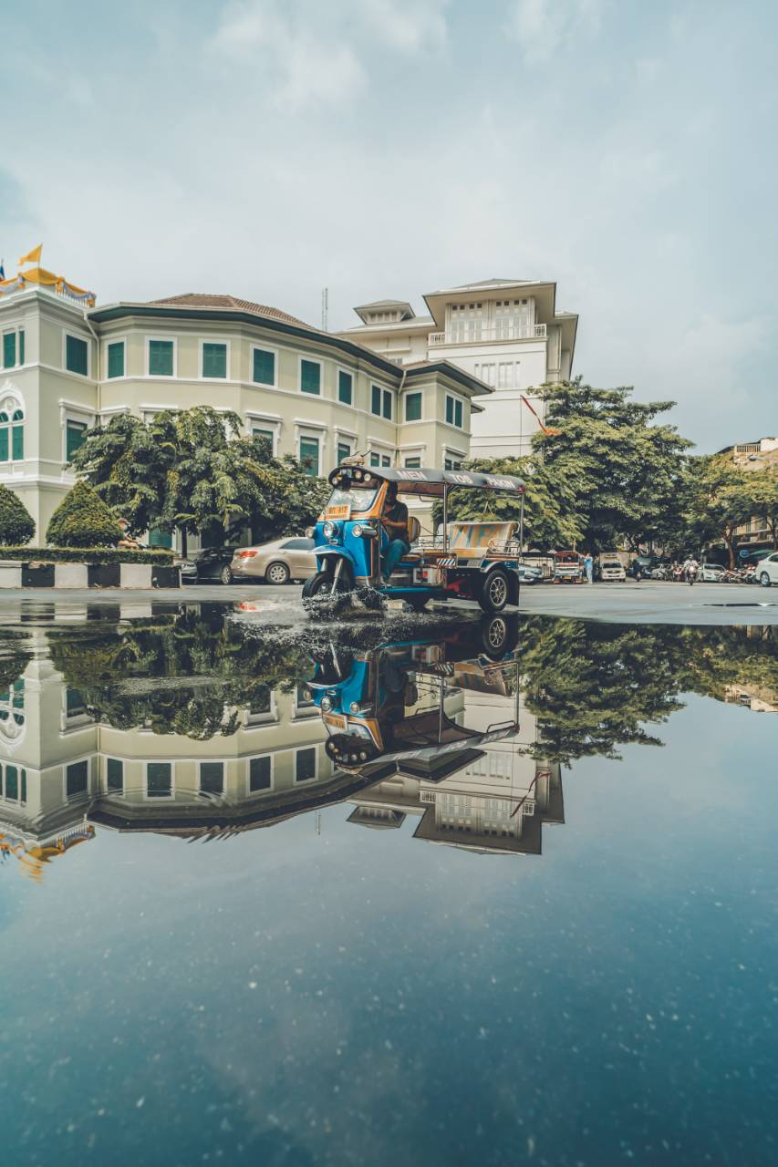 Puddle of water reflects the city near the Wat Sakhet in Bangkok