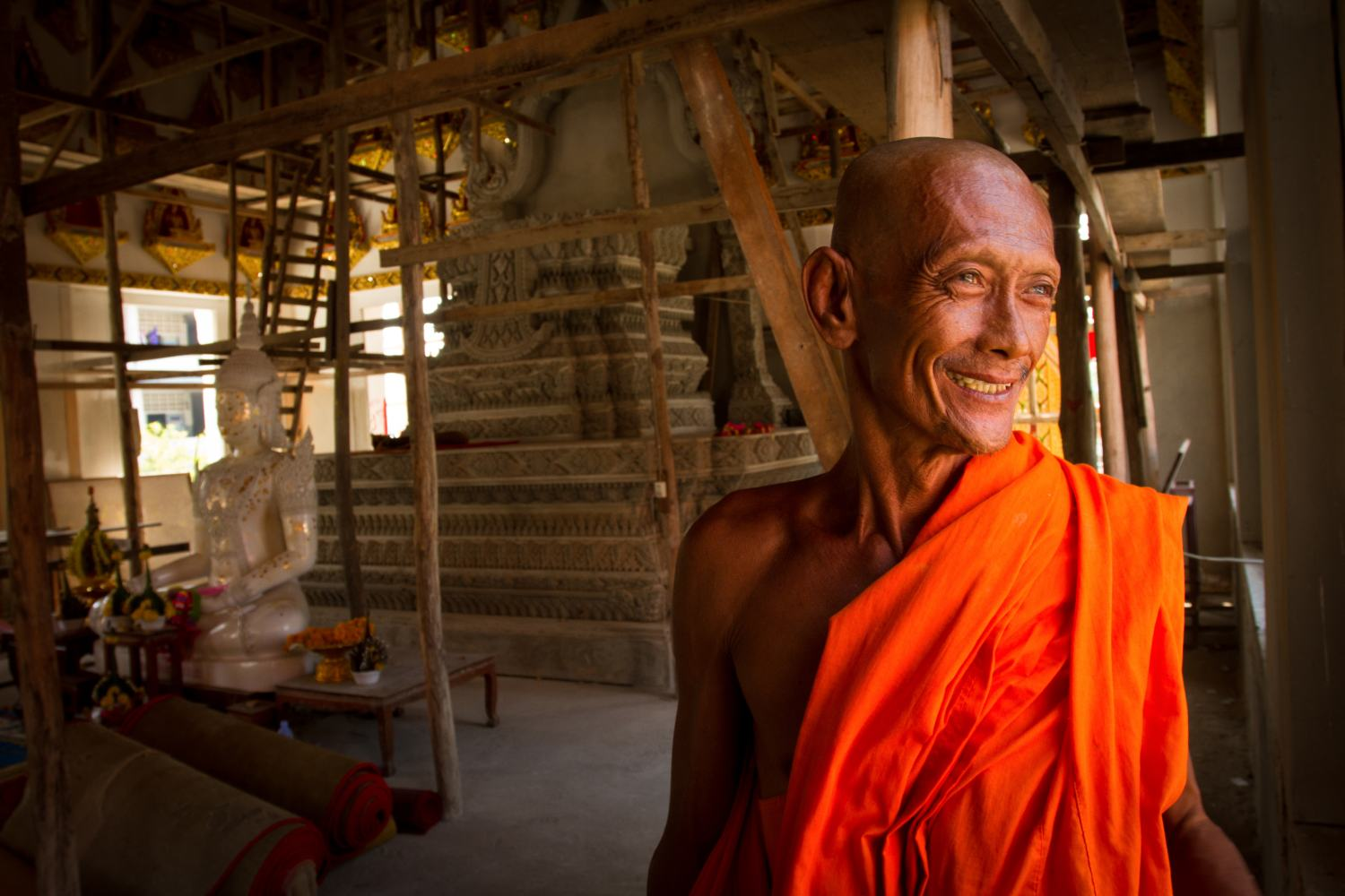 An elderly monk smiles while showing me around his temple that is being built in the cultural city of Sukhothai.