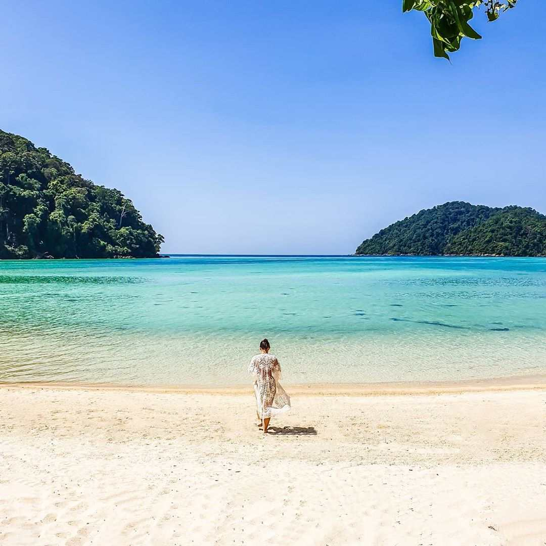 Woman on the beach of one of the Surin islands