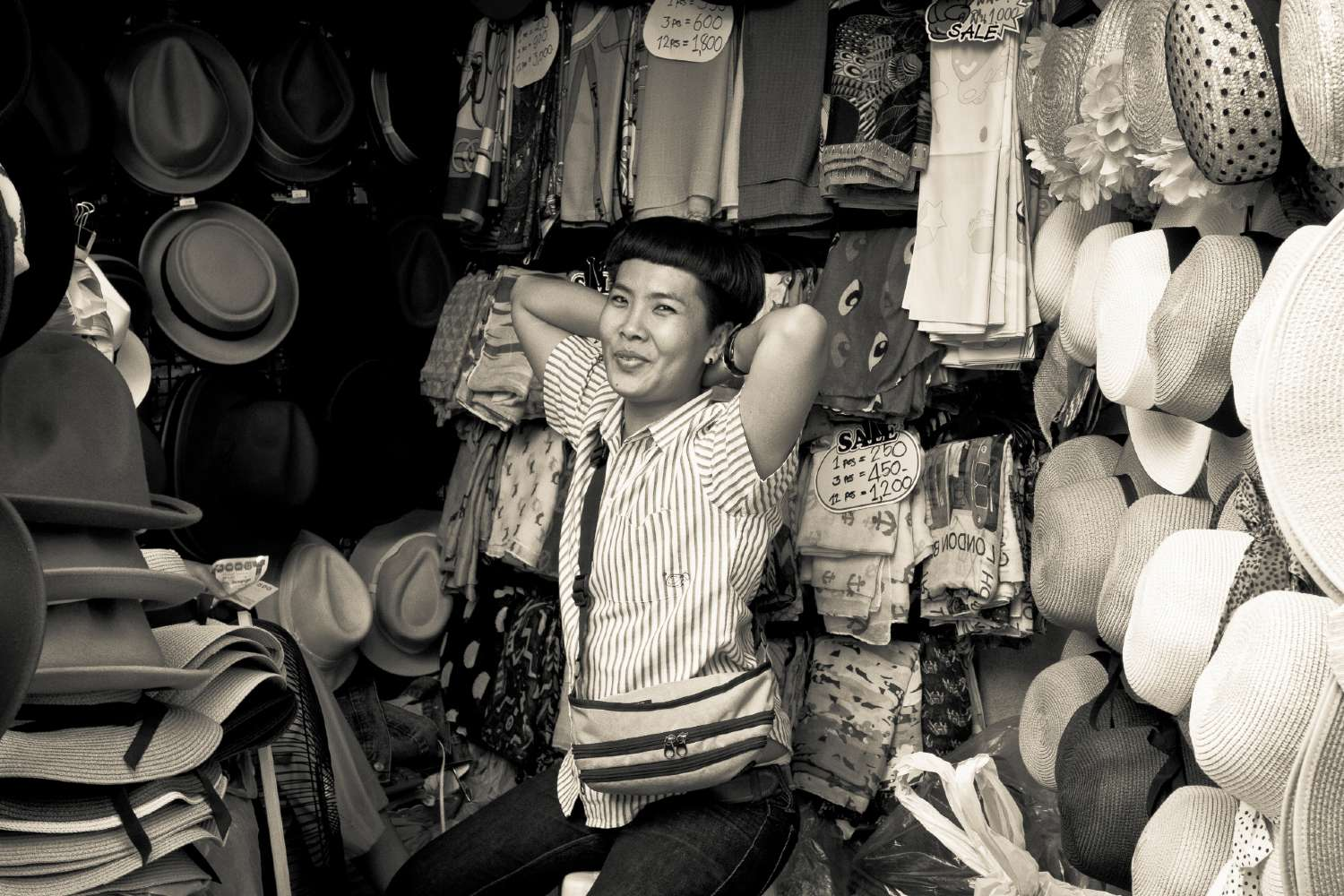 Whilst taking street photography in Bangkok I captured a hat seller in Yaowarat market by surprise and she gave a lovely smile.