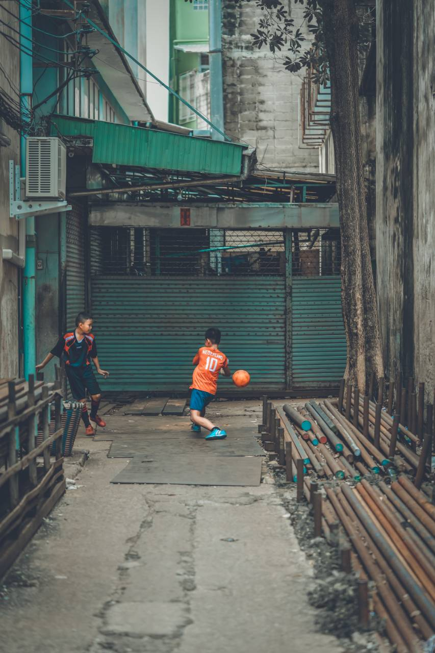 An improvised soccer field for these two soccer fans in Chinatown