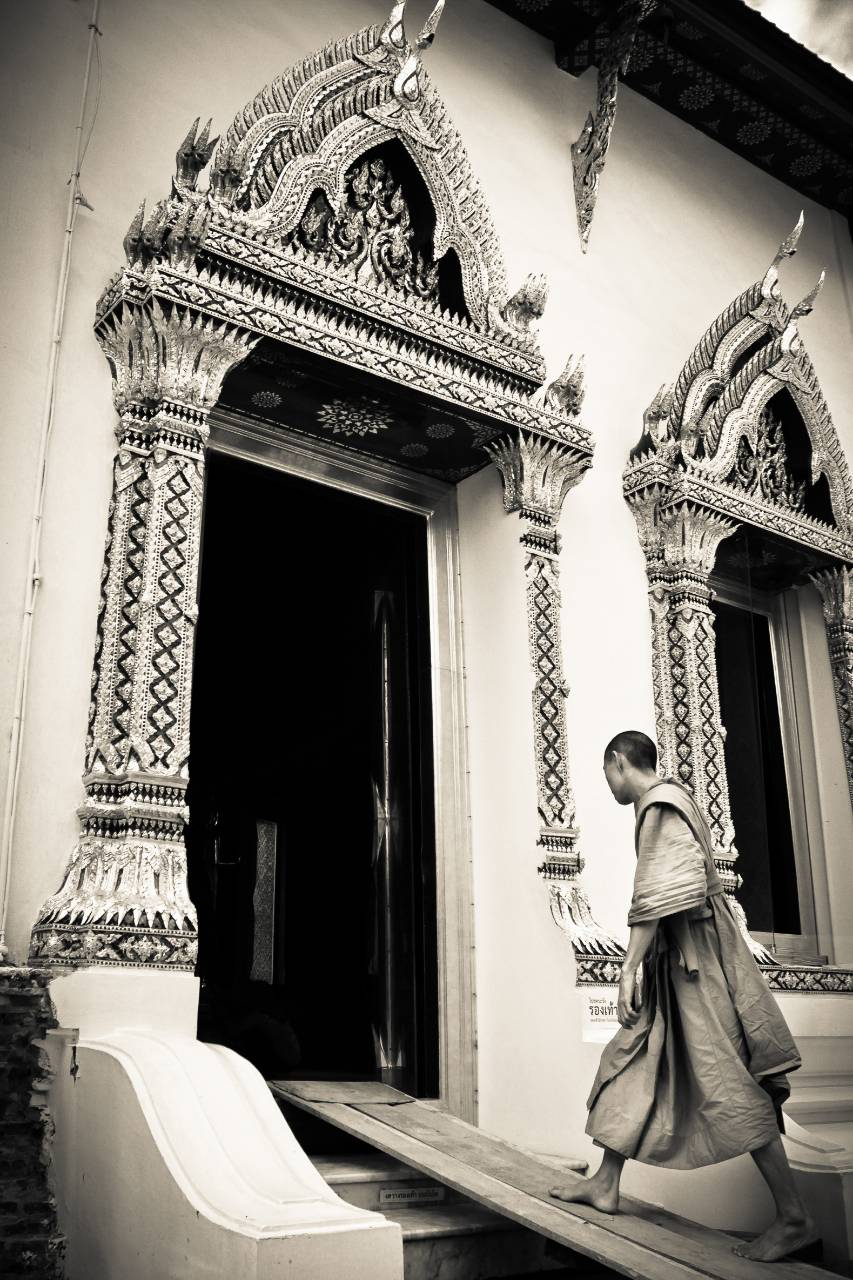 A monk enters the ornate doors of Buddhist temple of Wat Chana Songkhram in the heart of Bangkok's tourist area of Banglamphu.