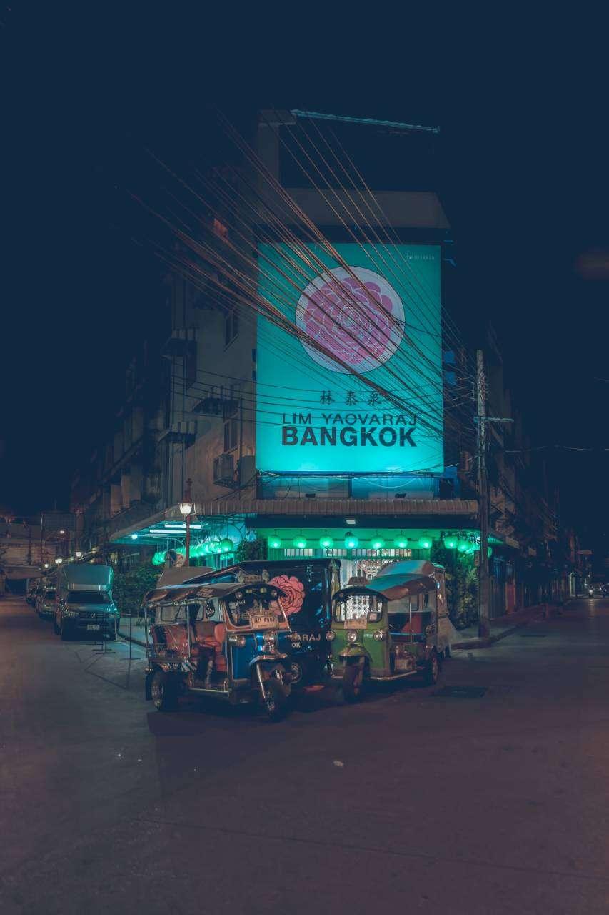 Large illuminated sign at street food stall in Chinatown, Bangkok