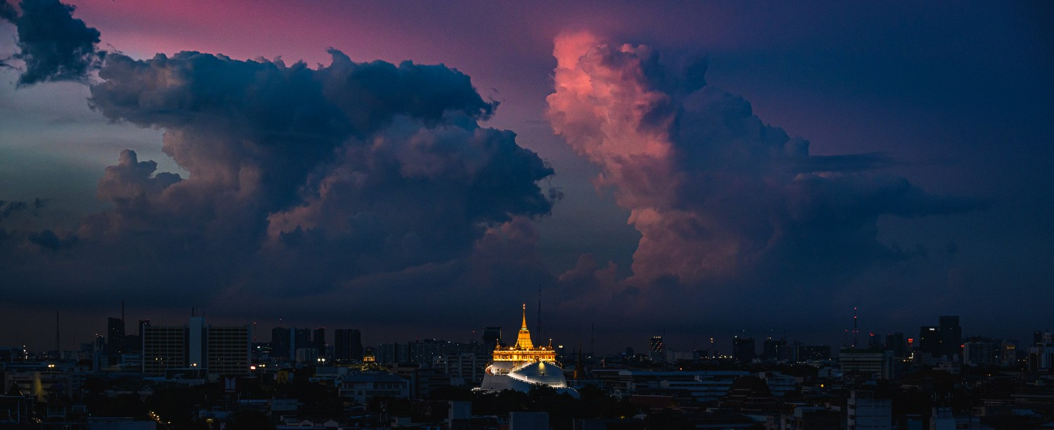 Wat Saket is kissed by the sun's rays after a spicy rain shower