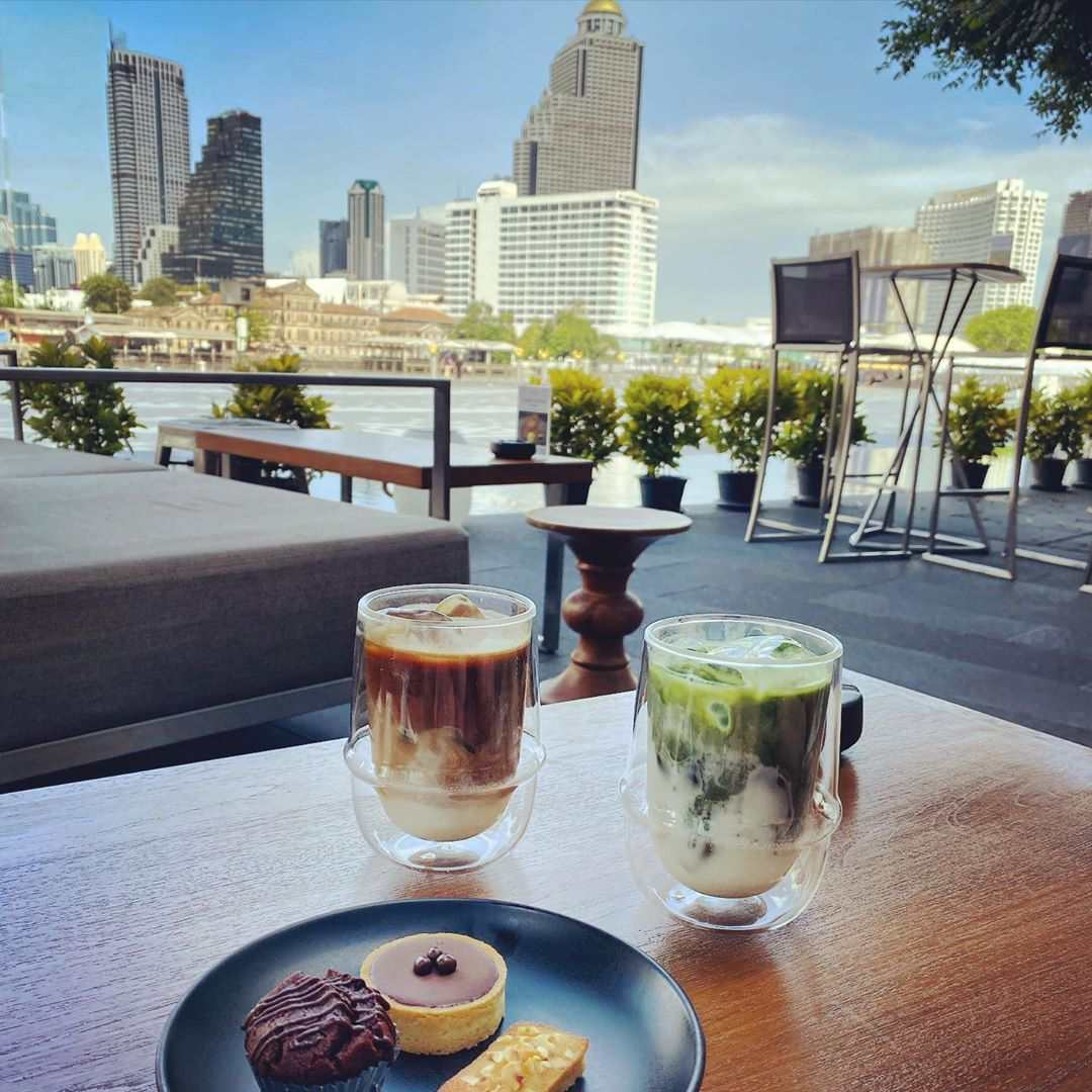 Coffee with sweet snacks on the terrace of D'ARk outside at The Veranda of ICONLUXE, part of ICONSIAM in Bangkok, Thailand.