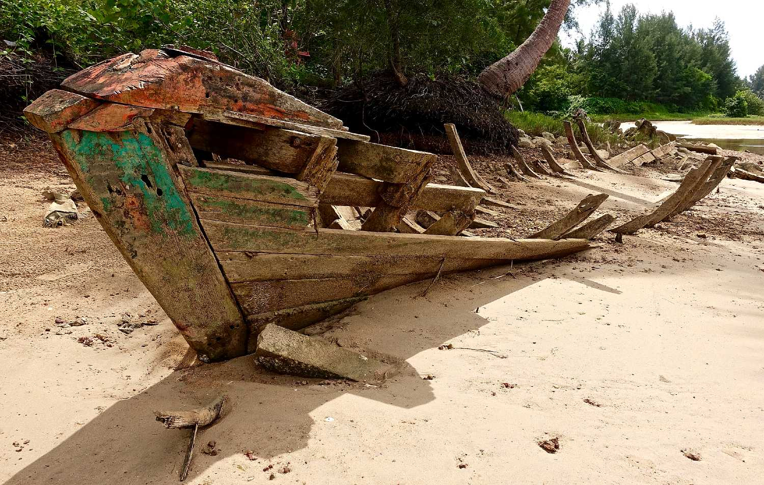 Old half decayed fishing boat on the beach