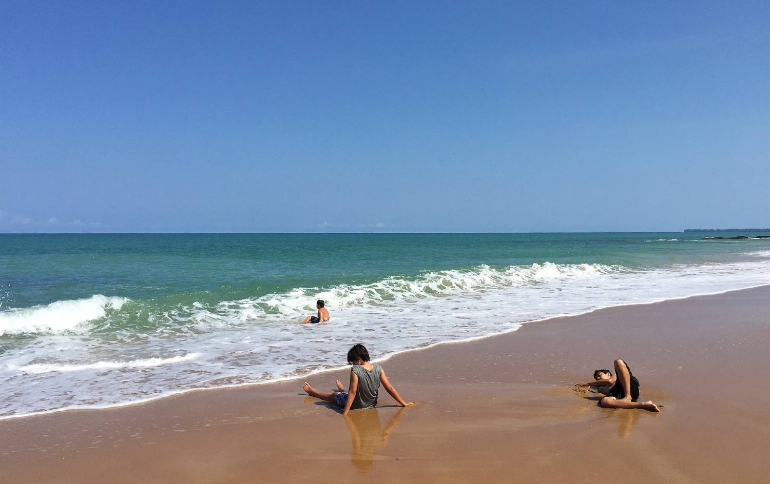 golden yellow beach, Nang Thong Beach with children playing in the sand and waves