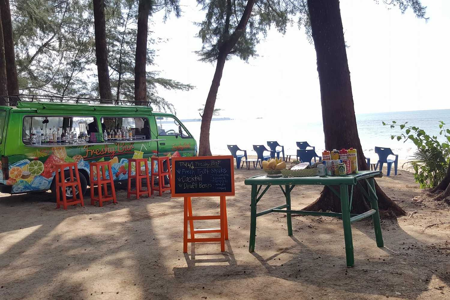 Bus of Freshy Bar on the beach with plastic chairs, sale of cocktails on the beach