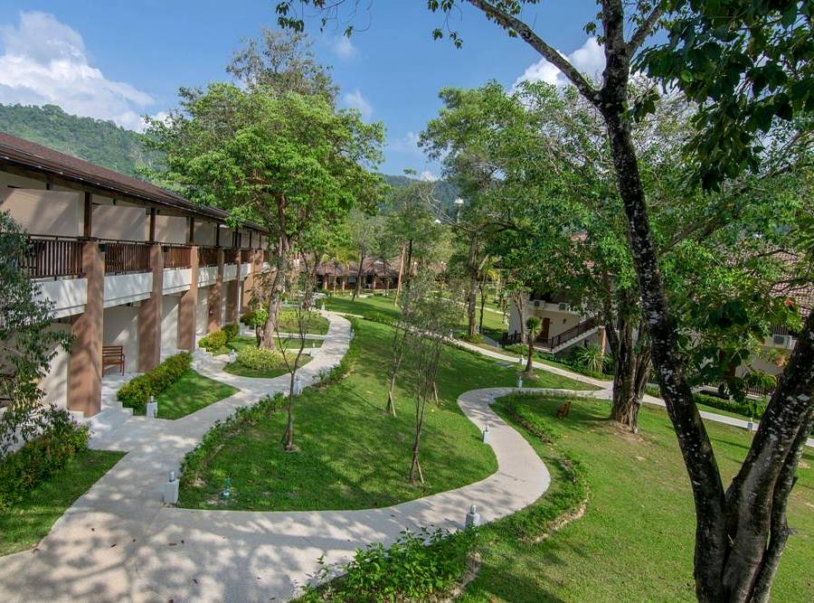 Resort on a hill in garden with trees near Nang Thong Beach