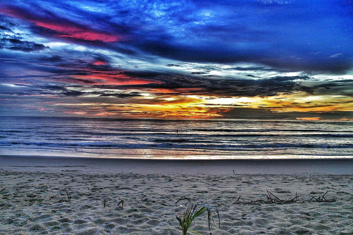 white deserted beach with colorful sunset