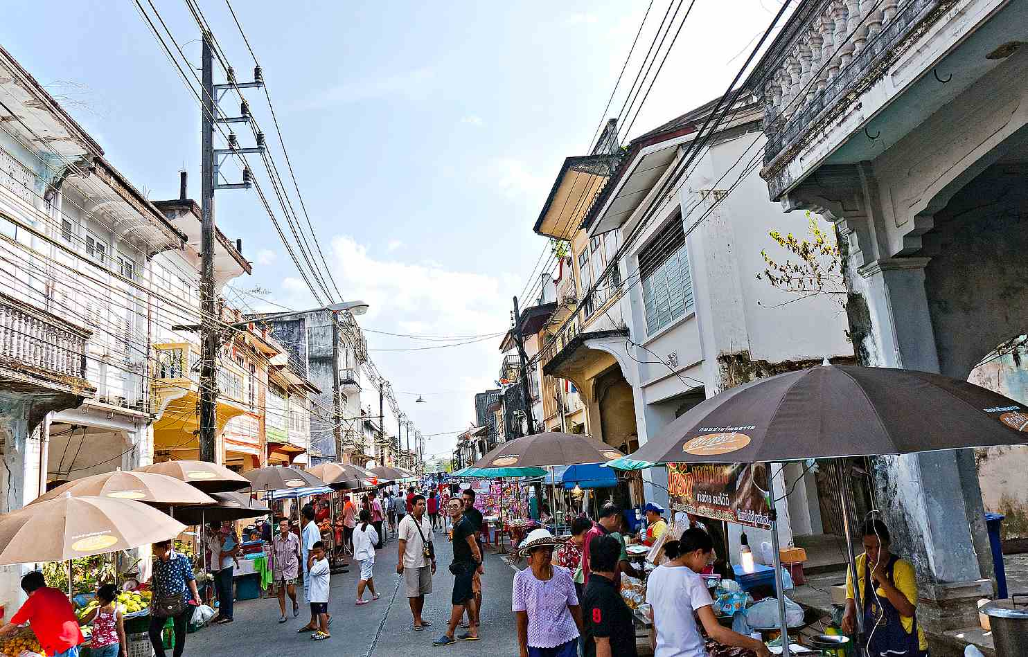 People shopping and street stalls in Takua Pa Old Town Market
