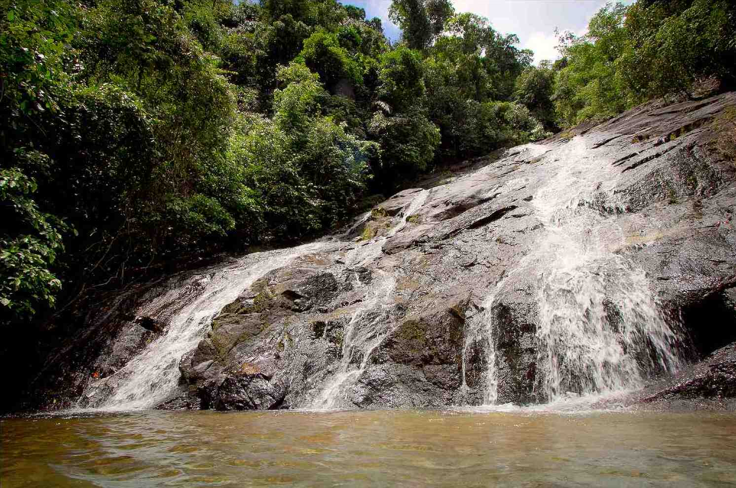 Swimming at Ton Prai waterfall in National Park Khao Lak